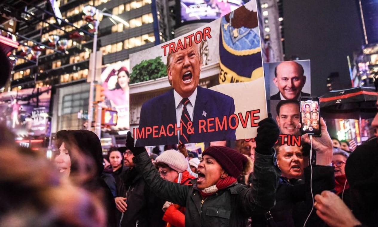 O presidente Donald Trump é constantemente tratado como 'traidor' nos protestos que se espalharam pelo país Foto: Stephanie Keith / Getty Images / AFP