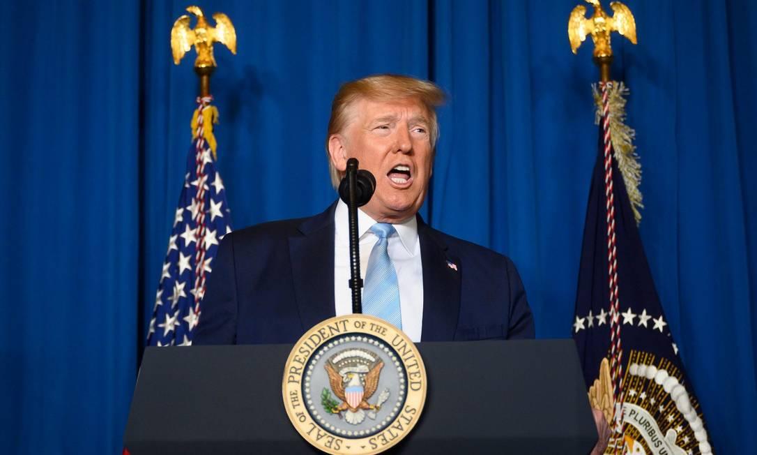 O presidente dos Estanos Unidos, DOnald Trump, em seu resort em Mar-a-Lago, em Palm Beach, na Flórida Foto: JIM WATSON / AFP