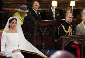 Meghan Markle em seu casamento, em maio de 2018, é observada por parte da família real Foto: JONATHAN BRADY / AFP