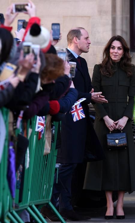 Uma semana depois da renúncia do irmão, Harry, ao cargo de membro sênior da família real e do início de uma crise no núcleo principal dos Windsor, William voltou às atividades ao lado de Kate Middleton Foto: OLI SCARFF / AFP