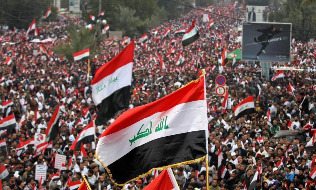 Milhares de pessoas tomaram as ruas do Iraque para demandar a saída dos militares americanos Foto: AHMAD AL-RUBAYE / AFP