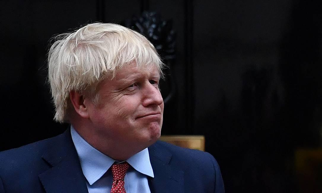 Primeiro-ministro britânico, Boris Johnson, assiste a performance do Ano Novo Chinês, em Londres Foto: BEN STANSALL / AFP