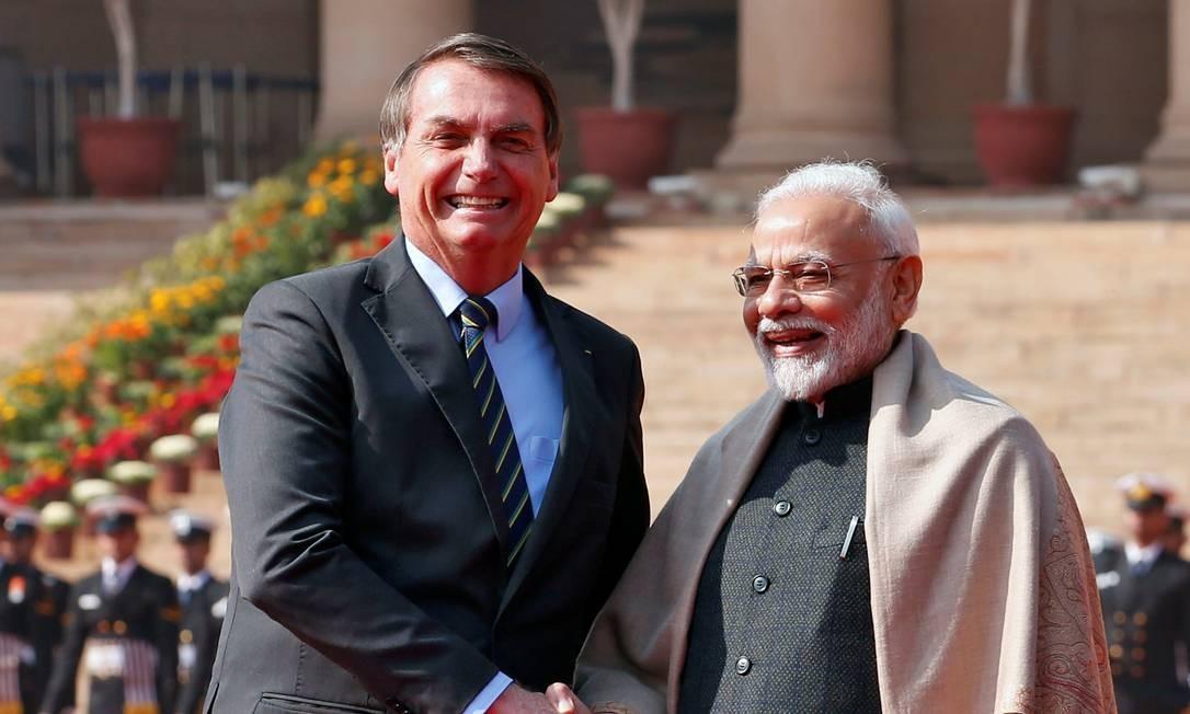 Jair Bolsonaro, presidente do brasil, e Narendra Modi, primeiro-ministro da Índia, durante a assinatura de acordos bilaterais Foto: Altaf Hussain / Reuters