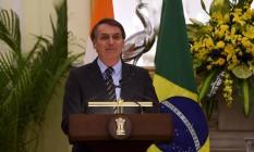 O presidente brasileiro Jair Bolsonaro fala durante entrevista coletiva em Nova Délhi Foto: MONEY SHARMA / AFP