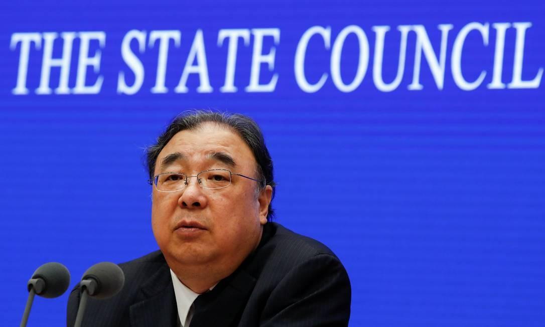 Ministro da Comissão Nacional de Saúde da China, Ma Xiaowei, conversou com repórteres neste domingo. Foto: THOMAS PETER / REUTERS