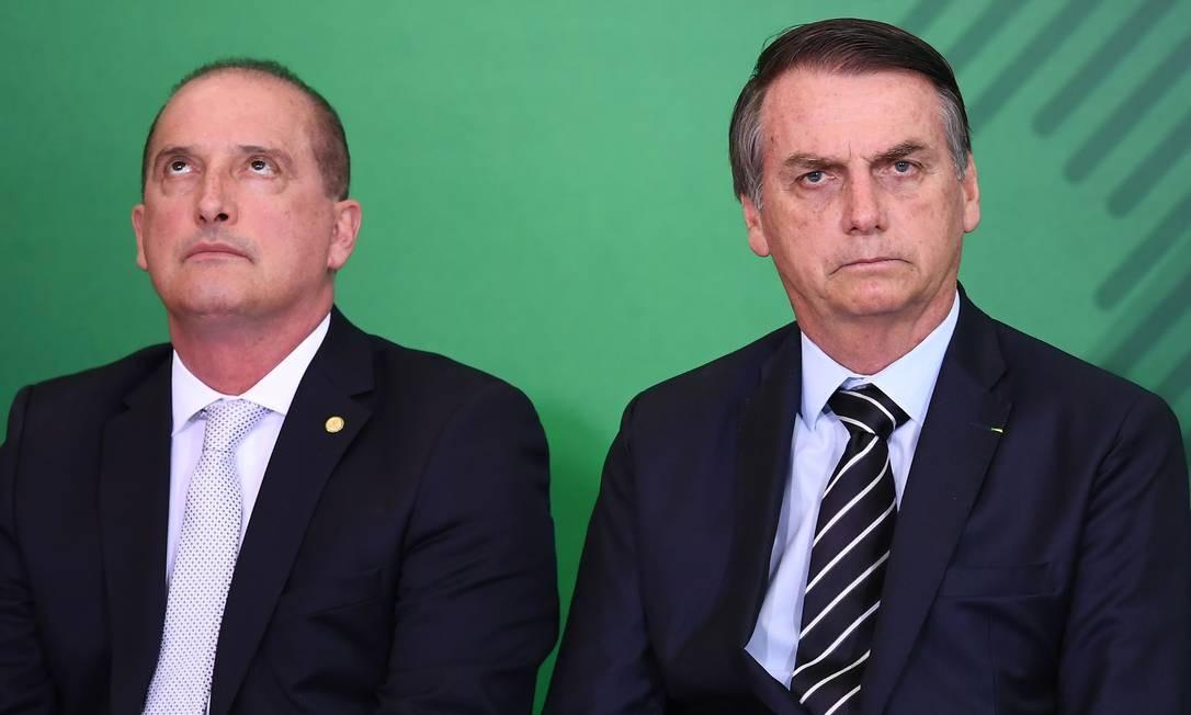 Presidente Jair Bolsonaro e o ministro da Casa Civil, Onyx Lorenzoni Foto: EVARISTO SA / AFP