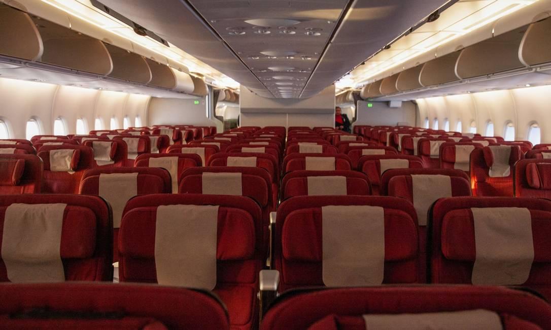 Com queda no número de passageiros, voos decolam com assentos vazios Foto: Hollie Adams / Bloomberg