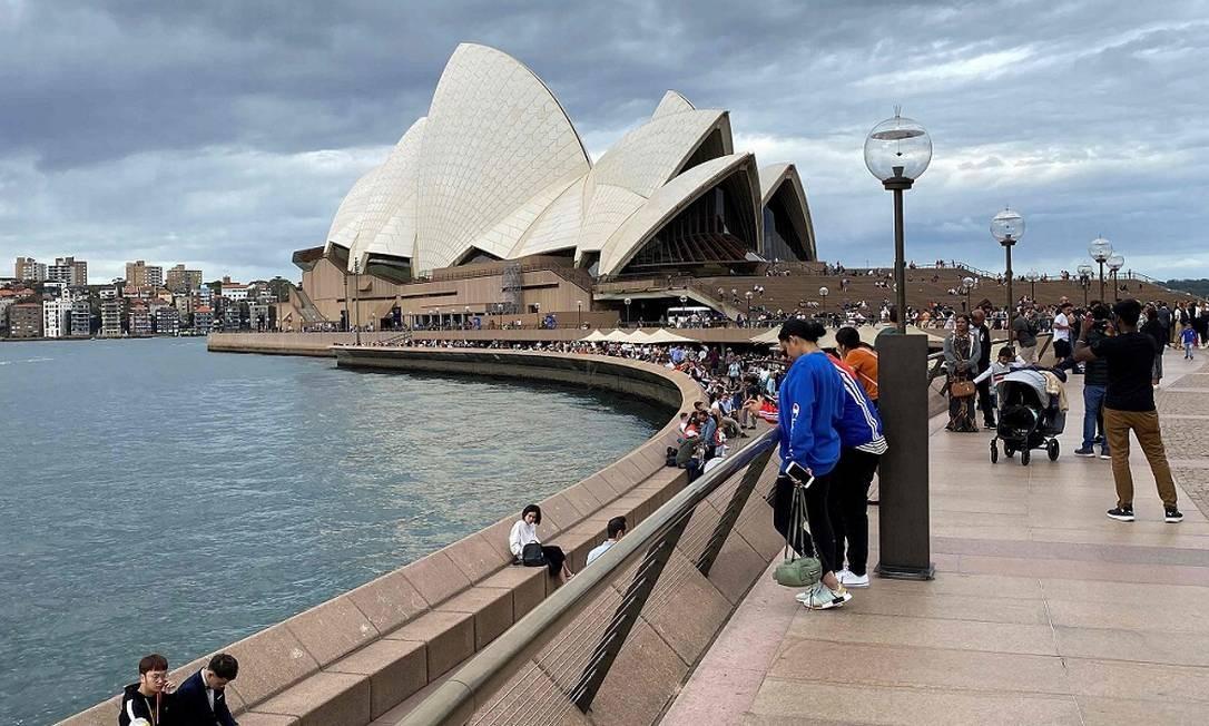 Depois: o principal cartão-postal da maior cidade australiana praticamente sem ninguém por perto Foto: Saeed Khan / AFP