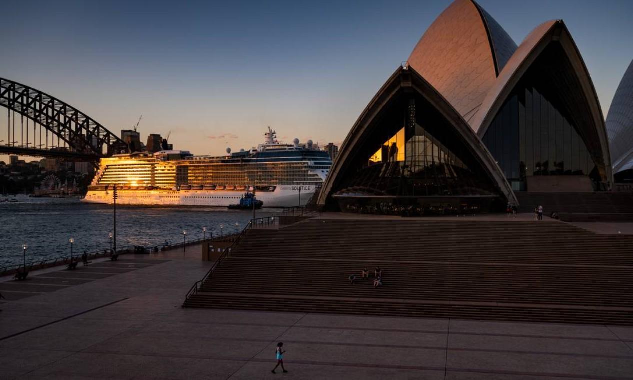 O pôr do sol é normalmente o melhor momento para tirar fotos na Opera House, em Sydney, Austrália Foto: Matthew Abbott / NYT