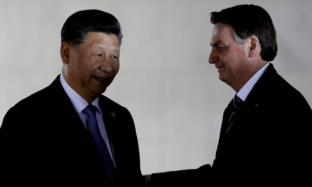 Xi Jinping, presidente da China, e Jair Bolsonaro, presidente do Brasil Foto: Jorge William / Agência O Globo
