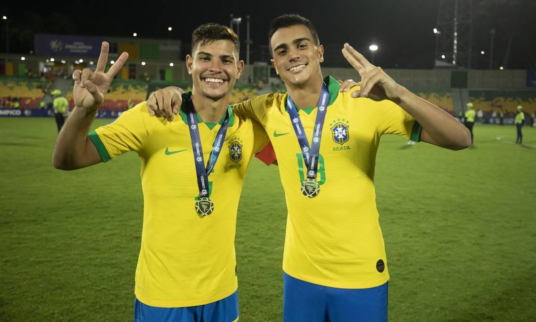 Bruno Guimarães ao lado de Reinier Foto: Lucas Figueiredo/CBF