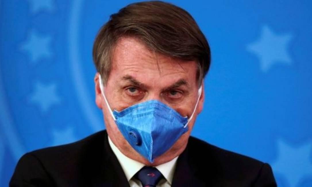 Presidente Jair Bolsonaro de máscara, medida de prevenção ao novo coronavírus Foto: Reuters