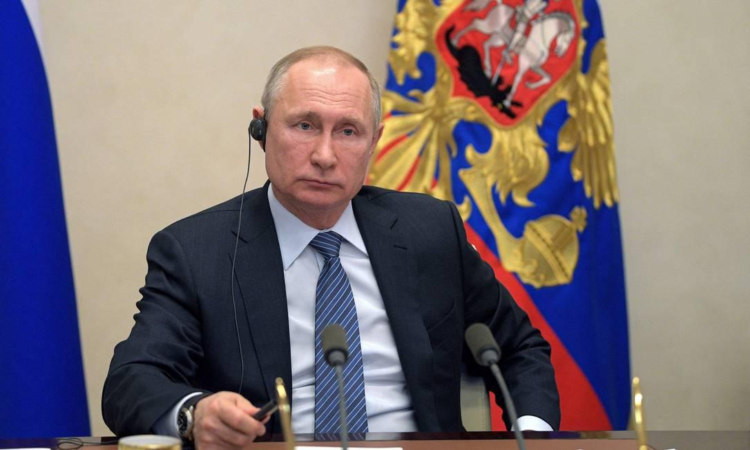 Vladimir Putin, presidente da Russia. Governo confirmou que um de seus integrantes contraiu o novo coronavírus Foto: Alexey Druzhinin / AFP