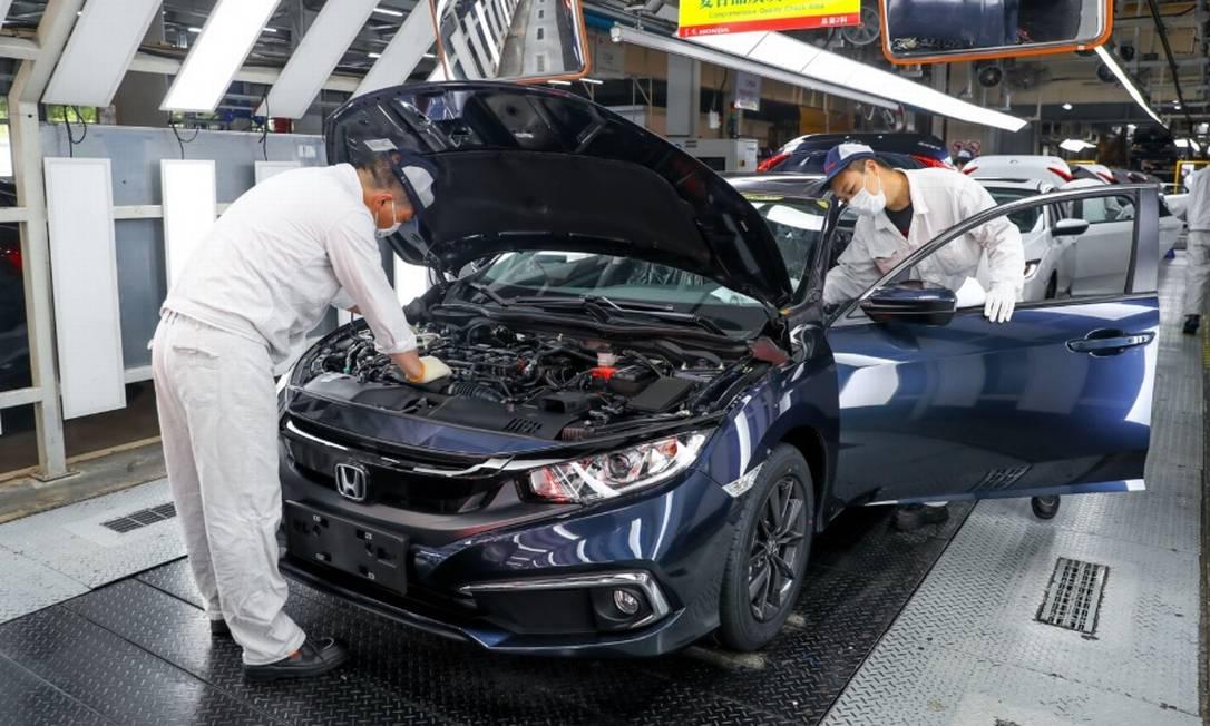 Trabalhadores da indústria de automóveis Foto: Bloomberg