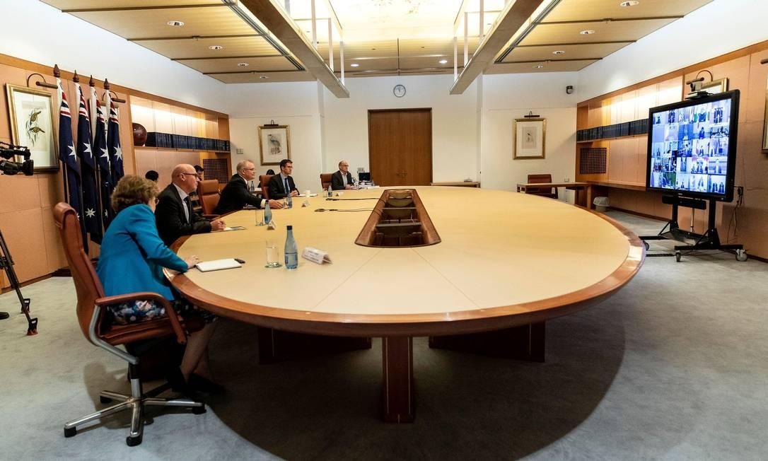 Primeiro ministro australiano Scott Morrison em uma conferência do G20 para discutir sobre os impactos do coronavirus, COVID-19, em 26 de março de 2020 Foto: GARY RAMAGE / AFP