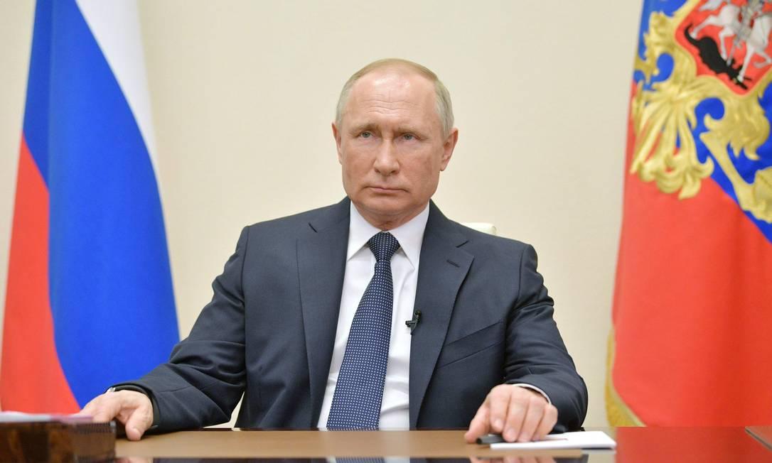 Presidente russo Vladimir Putin em pronunciamento em rede nacional sobre medidas do país contra o novo coronavírus Foto: ALEXEI DRUZHININ / AFP