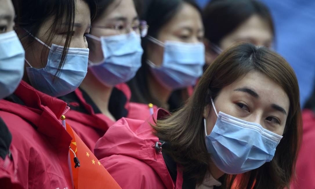 Médicos se voluntariam para ajudar a combater o surto de coronavírus em Wuhan Foto: NOEL CELIS / AFP/31-03-2020