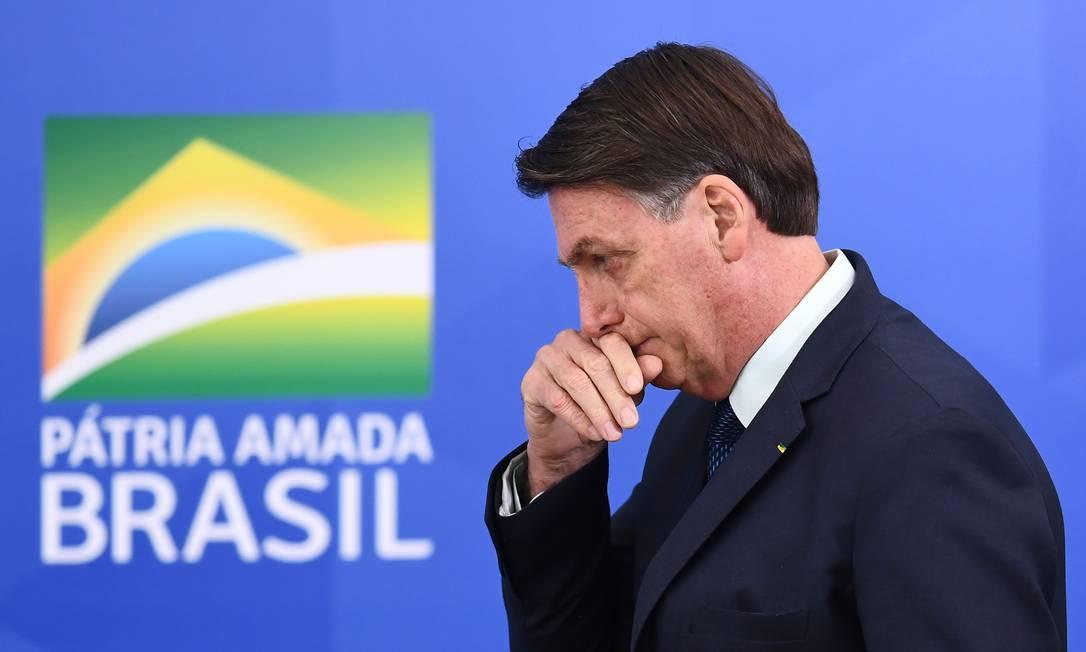 O presidente Jair Bolsonaro em solenidade no Palácio do Planalto Foto: EVARISTO SA / AFP
