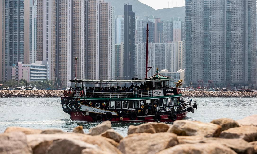 Hong Kong comemora número pequeno de casos da Covid-19 comparado a outras metrópoles do mundo Foto: ISAAC LAWRENCE / AFP