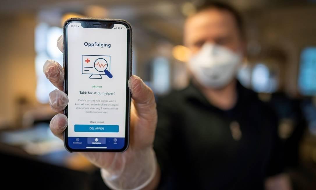 Noruega lança aplicativo de rastreamento de pessoas infectadas pela Covid-19 Foto: HEIKO JUNGE/AFP