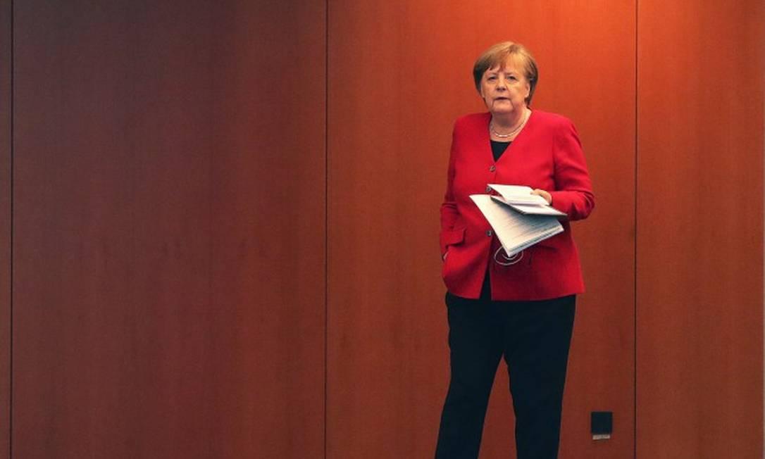 Chanceler Angela Merkel chega para entrevista coletiva em Berlim Foto: MICHAEL SOHN / AFP