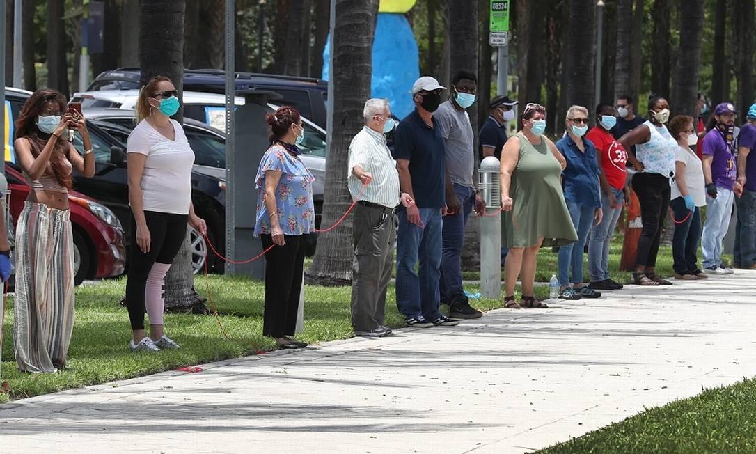 Desempregados protestam em Miami: taxa caiu inesperadamente. Foto: JOE RAEDLE / AFP