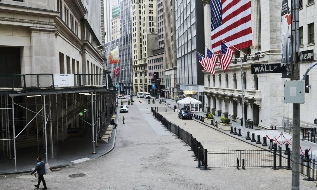 O centro financeiro de Nova York praticamente deserto por causa da pandemia de coronavírus Foto: Gabby Jones / Bloomberg