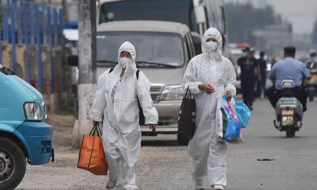 Mercado de Xifandi é novo foco de coronavírus na China Foto: GREG BAKER / AFP