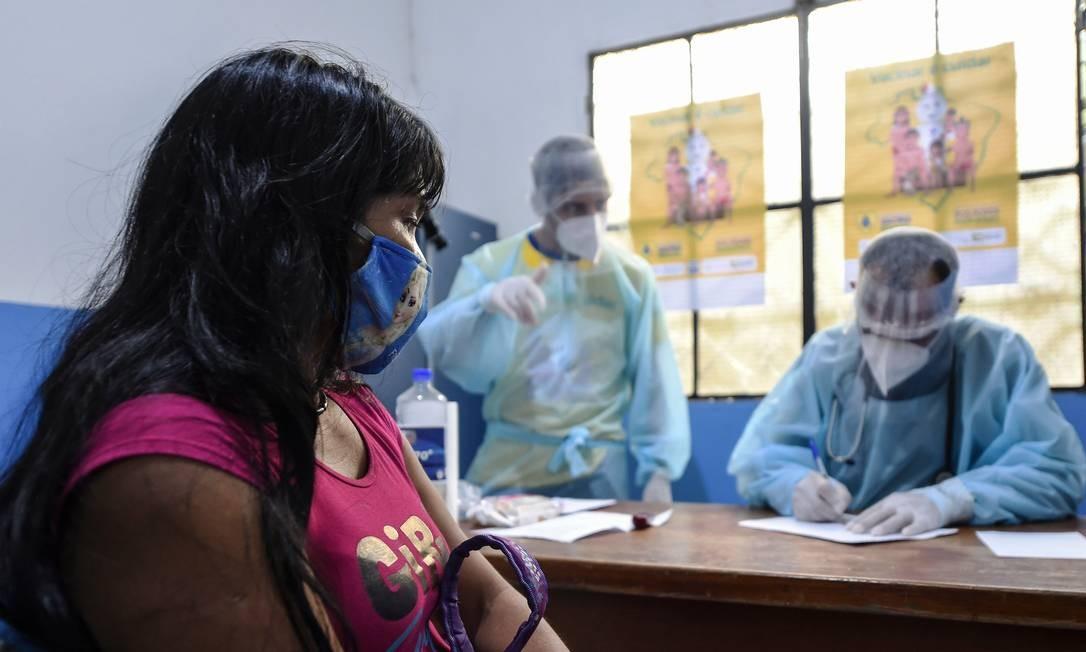 Indígena é diagnosticada com Covid-19: críticas à falta de ação da Funai Foto: EVARISTO SA / AFP