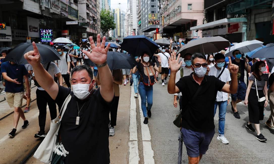 Manifestantes protestam contra a lei de segurança nacional Foto: TYRONE SIU / REUTERS