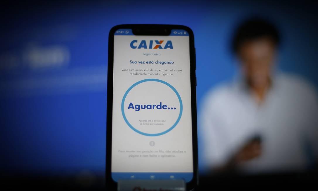 Aplicativo da Caixa Economica Federal pelo qual beneficiários têm acesso ao auxílio emergencial de R$ 600 Foto: Lucas Tavares/Zimel Press / Agência O Globo