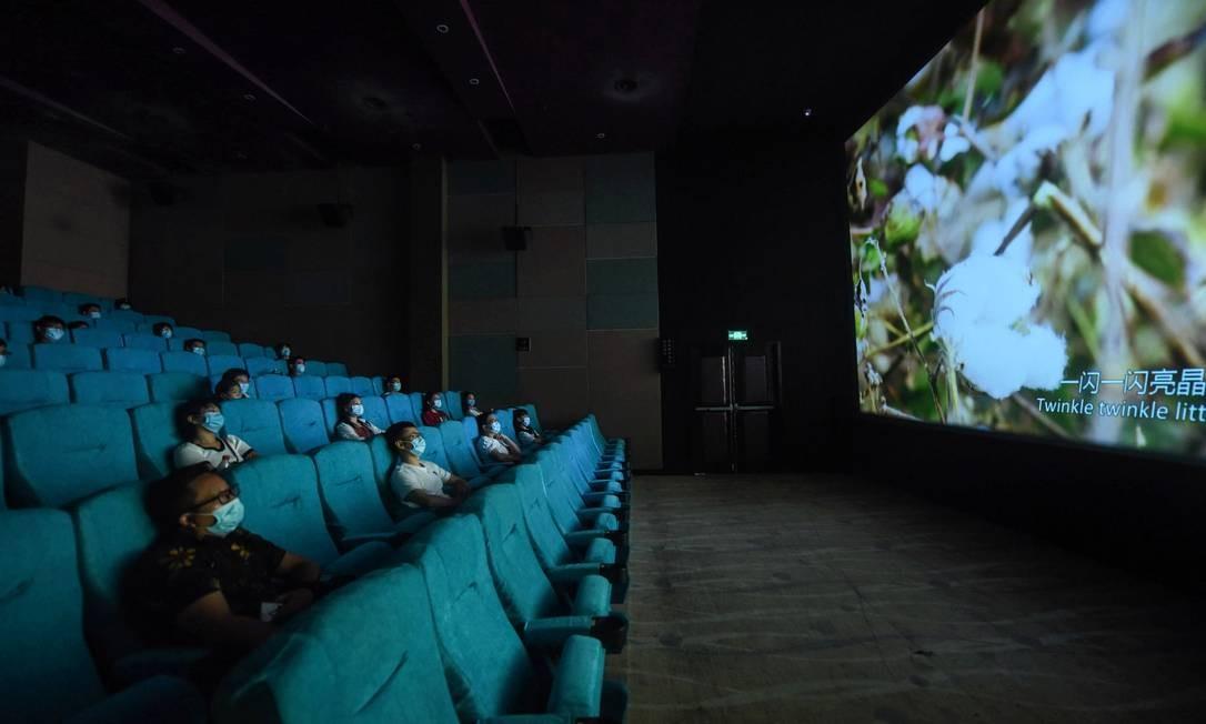 A ocupação dos cinemas foi limitada a 30% da capacidade para garantir o distanciamento social Foto: STR / AFP