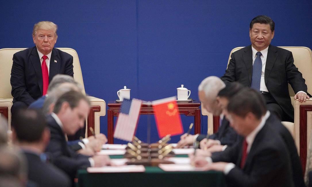 Os presidentes americano Donald Trump e chinês Xi Jinping Foto: Nicolas Asfouri / AFP