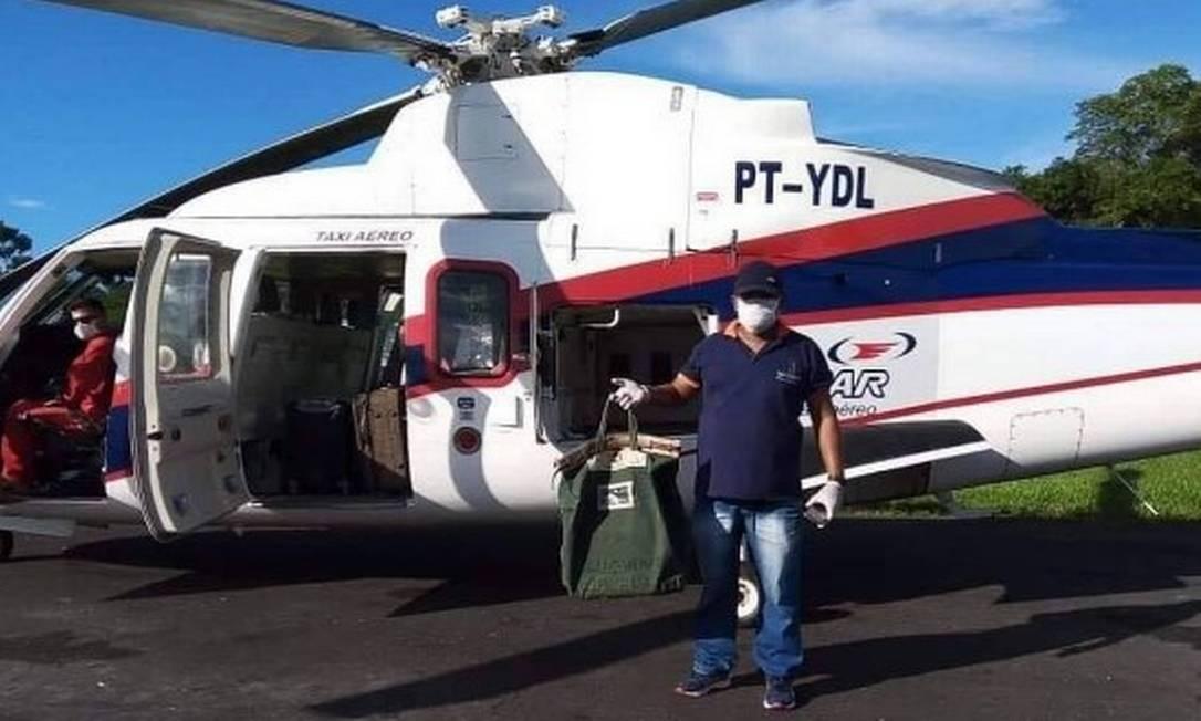 Amostras de exames para Covid-19 são levadas de Parintins, no interior do Amazonas, a Manaus: cidade que já registrou uma morte tem toque de recolher Foto: Divulgação/Prefeitura de Parintins