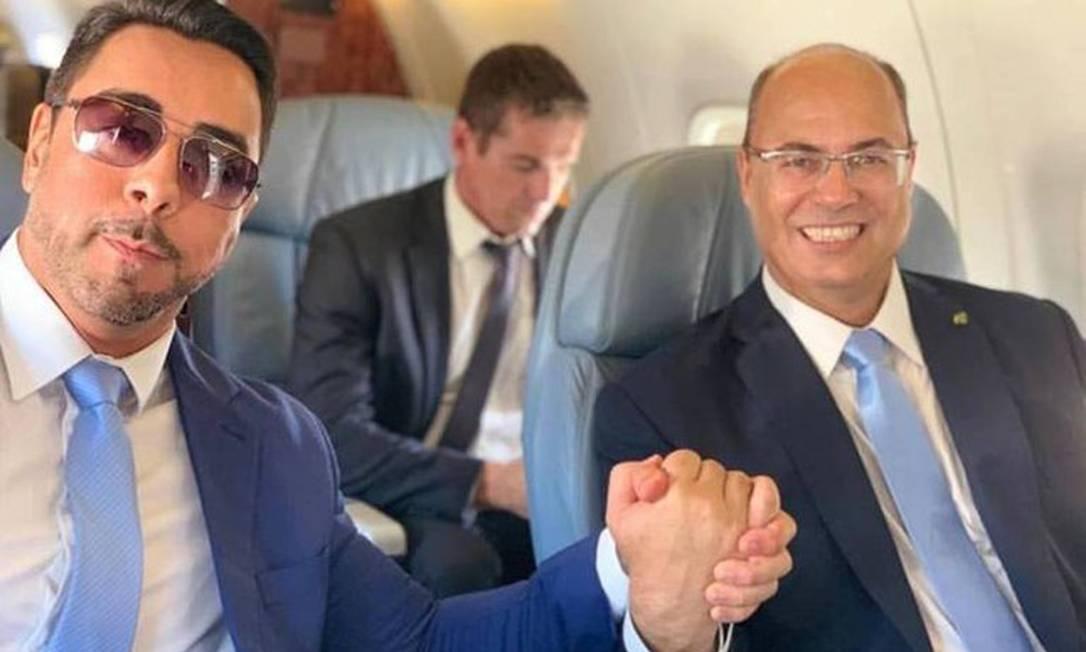 Marcelo Bretas e Wilson Witzel durante uma viagem de avião, em abril de 2019. Em maio deste ano, juiz da Lava-Jato no estado, reagiu às críticas do governador, e ex-aliado, sobre a condução do inquérito que investiga fraudes na Saúde Foto: Reprodução / Instagram