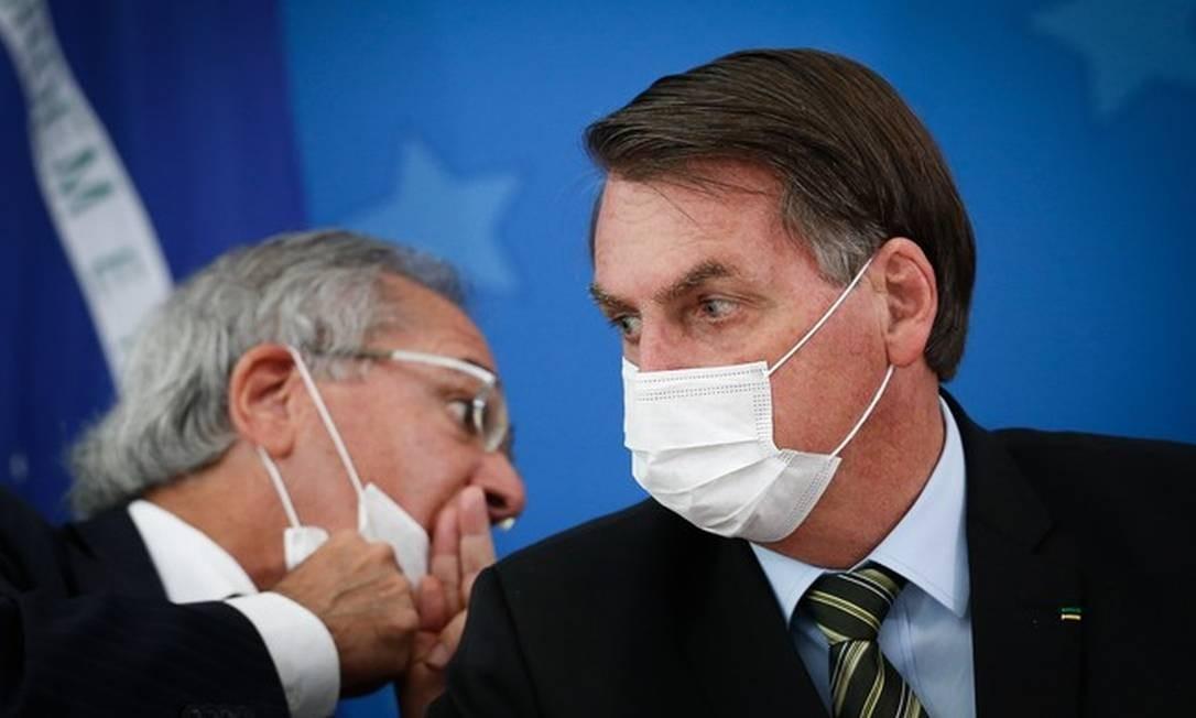 Presidente Jair Bolsonaro e ministro Paulo Guedes Foto: Pablo Jacob/Agência O Globo