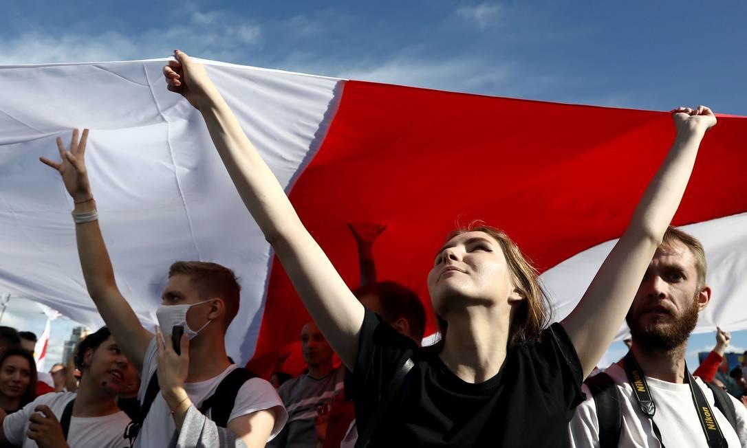 """Manifestação deste domingo recebeu o nome de """"Marcha dos heróis"""", em referência às vítimas da repressão Foto: - / AFP"""