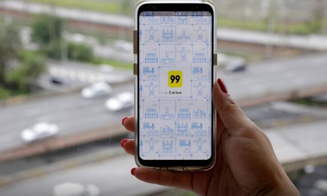 Fundada em 2012 como uma plataforma para motoristas de táxi, depois aberta para autônomos, a 99 se tornou o primeiro unicórnio brasileiro em janeiro de 2018, após ser adquirida pela chinesa Didi Chuxing em negócio avaliado em US$ 1 bilhão. Foto: REUTERS/Paulo Whitaker