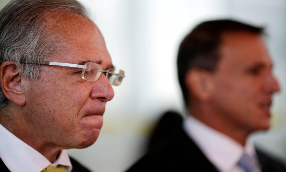 O ministro da Economia, Paulo Guedes, e o senador Márcio Bittar Foto: Ueslei Marcelino / Reuters