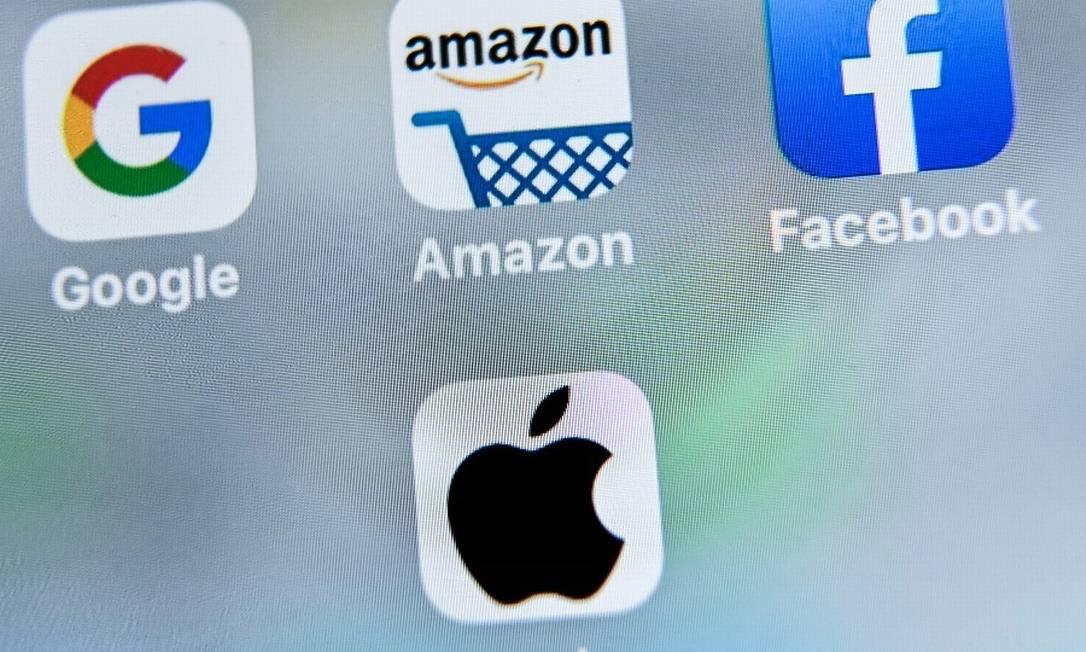 As quatro gigantes de tecnologia acusadas no relatório: Google, Amazon, Facebook e Apple. Foto: DENIS CHARLET / AFP