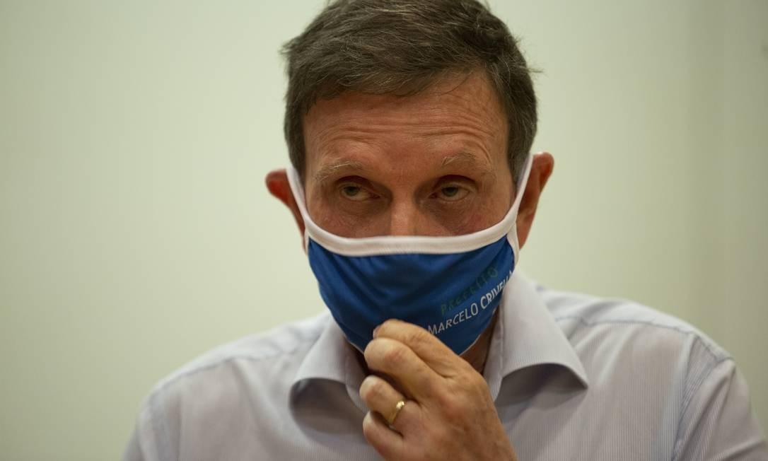 O prefeito do Rio, Marcelo Crivella: liminar no TSE deve garantir registro de candidatura Foto: Gabriel Monteiro / Agência O Globo