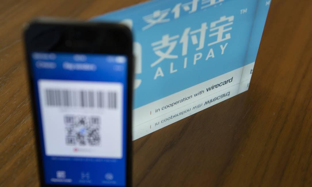 Compras no Taobao, do grupo Alibaba, só podem ser pagas com o Alipay, pertencente ao grupo Foto: Matthias Doering / Bloomberg