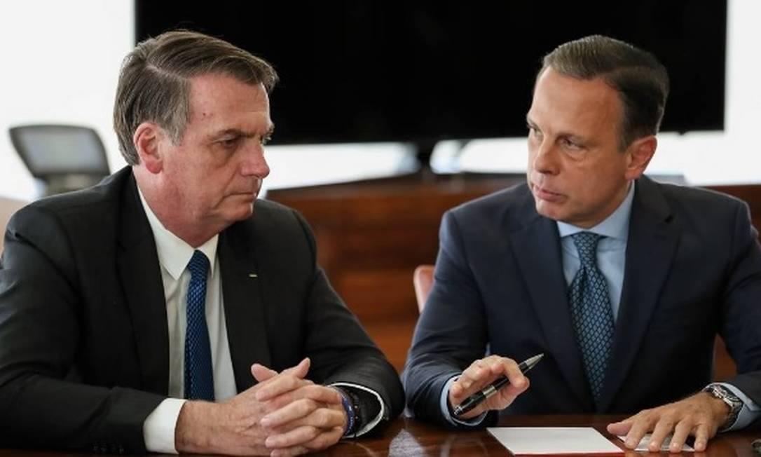 O presidente Jair Bolsonaro e o governador João Doria: rivais no debate sobre vacinação para a Covid-19 Foto: Marcos Corrêa/PR