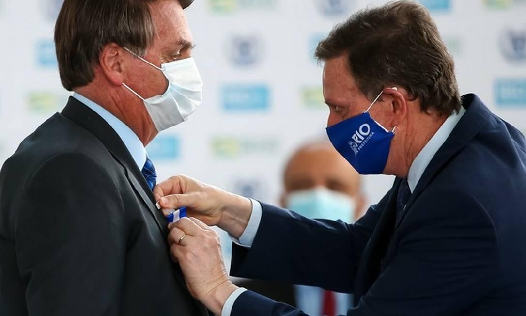 O presidente Jair Bolsonaro e o prefeito Marcelo Crivella durante agenda em setembro Foto: Buda Mendes / Getty Images