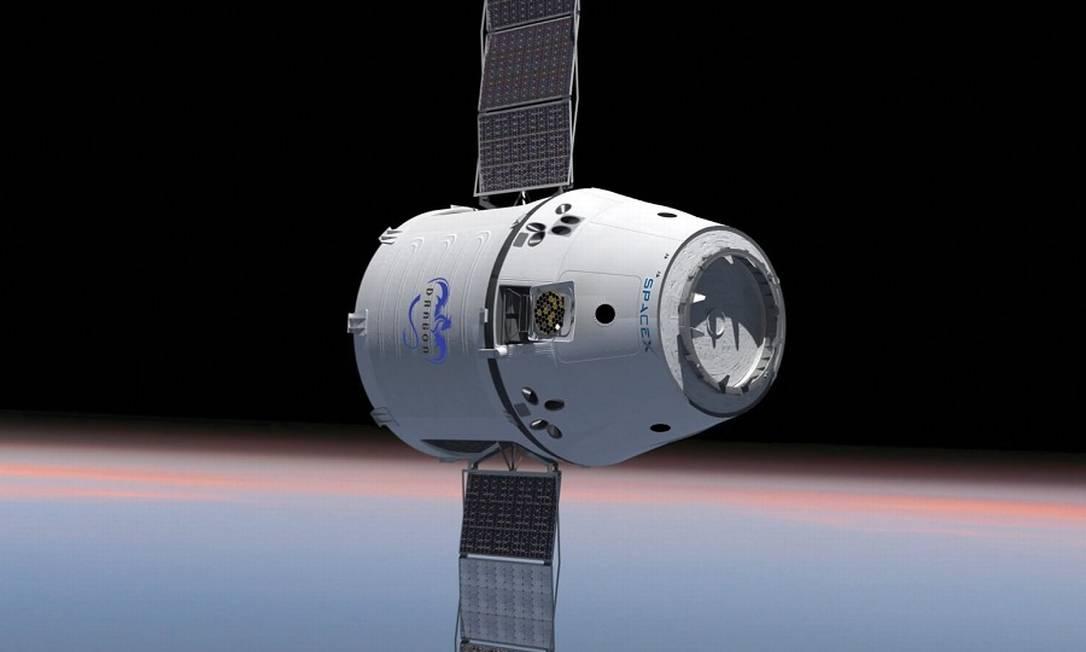 Representação da nave Dragão, da SpaceX Foto: AFP