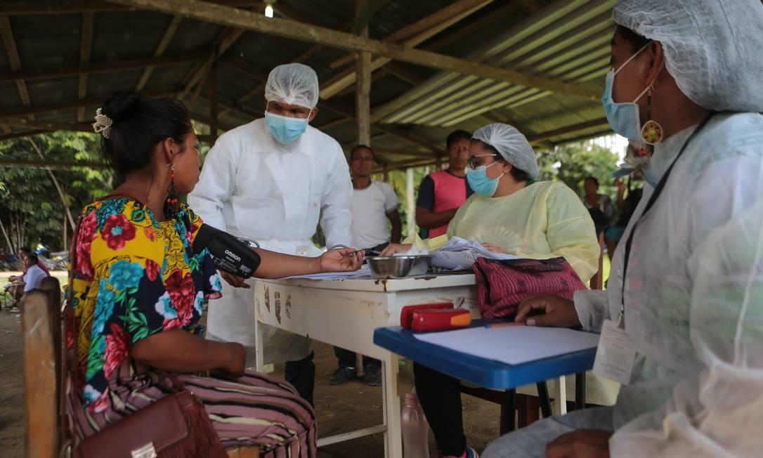 Missão Alto Solimões leva 27 profissionais de saúde para aldeias indígenas, como Campo Alegre, próximo a Tabatinga (AM) Foto: Jorge William / Agência O Globo