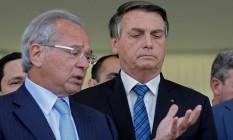 Bolsonaro com o ministro Paulo Guedess Foto: SERGIO LIMA / AFP