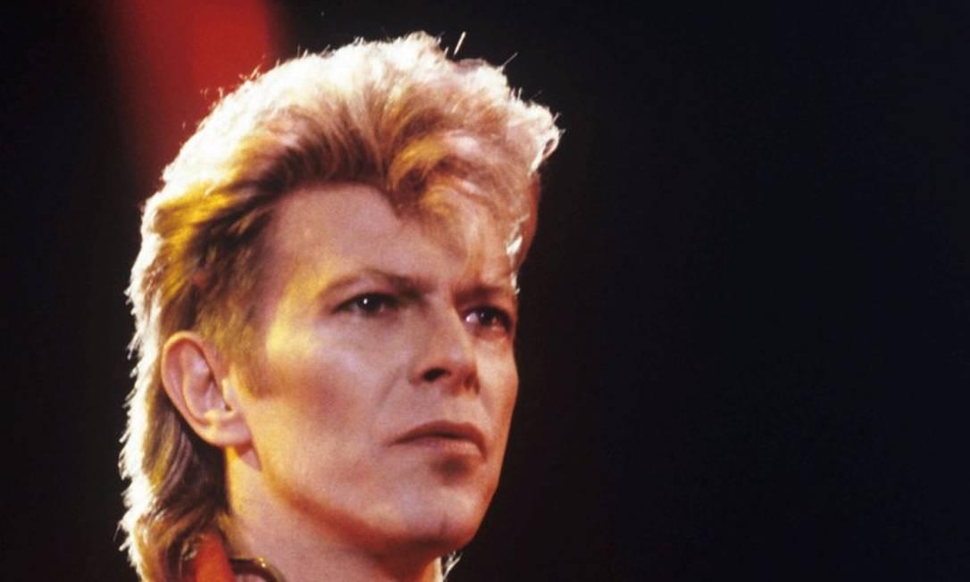 PASSADO: David Bowie,inspiração de mullet para uma geração inteira Foto: HARALD MENK / AFP