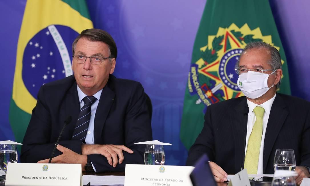 O presidente Jair Bolsonaro e o ministro da Economia, Paulo Guedes, participam de evento com investidores Foto: Marcos Corrêa/Presidência da República