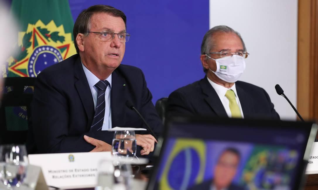 O presidente Jair Bolsonaro ao lado do ministro da Economia, Paulo Guedes Foto: Marcos Corrêa/PR / PR/26-1-2021